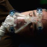 man wearing CPAP face mask, sleep apnea, OSA