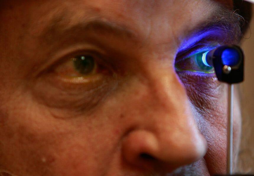 male patient undergoing eye exam